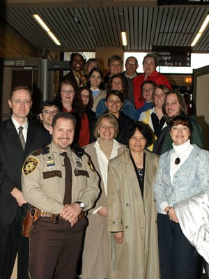 The Leadership Pocono Class of 2008 poses for a picture with Deputy Sheriff Joe Sparrow at the Monroe County Courthouse