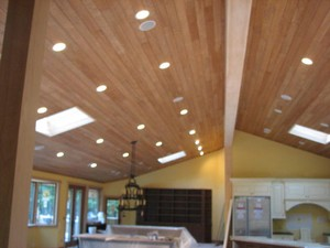 High-end speakers mounted in a tongue & groove ceiling.
